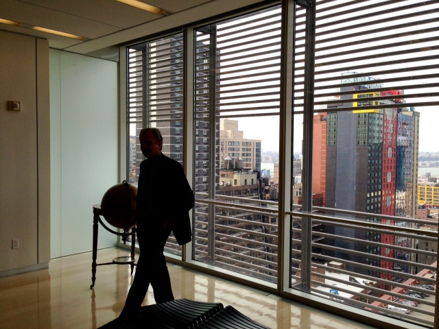 A silhouette of Arthur Suzberger Jr., publisher of The New York Times and chairman of The New York Times Company, against a window framing a Manhattan skyline.  Sulzberger hosted a lunch on Jan. 22 at The New York Times for the Wisconsin Center for Investigative Journalism to talk about the future of investigative journalism. In addition to Sulzberger, also present at the meeting were: Matt Purdy, deputy executive editor at The New York Times, Walt Bogdanich, NYT investigative reporter and editor, and an alumnus of the University of Wisconsin-Madison School of Journalism and Mass Communication; Sarah Cohen, editor of NYT computer-assisted reporting team and board president of Investigative Reporters and Editors; Robert Gebeloff, NYT data journalism specialist and a UW-Madison SJMC alumnus; Gloria Anderson, UW-Madison SJMC alumnus and former vice president for International and Editorial Development at NYT News Services Division; Brant Houston, WCIJ board president and the John S. and James L. Knight Foundation Chair in Investigative and Enterprise Reporting at the University of Illinois at Urbana-Champaign; Hemant Shah, WCIJ board member and director of the University of Wisconsin-Madison SJMC; Andy Hall, WCIJ founder and executive director; Lauren Fuhrmann, WCIJ associate director; Sara Jerving, former WCIJ intern and an environmental investigative reporting fellow at Columbia University Graduate School of Journalism; Alexandra Tempus, former WCIJ intern and a writer in New York; and me, Karen Lincoln Michel, WCIJ board vice president.